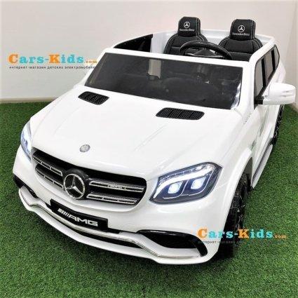 Электромобиль Mercedes-Benz GLS 63 AMG 4WD MP4 белый (сенсорный дисплей MP4, кондиционер, 2х местный, колеса резина, сиденье кожа, пульт, музыка)